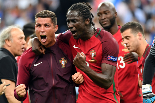 PARIS, FRANCE - JULY 10: Cristiano Ronaldo and Eder of Portugal celebrates after Portugal's 1-0 win against France during the UEFA EURO 2016 Final match between Portugal and France at Stade de France on July 10, 2016 in Paris, France. (Photo by Stanley Chou/Getty Images)